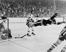 Orr is tripped and flies through the air after scoring the game winning overtime goal to win the 1970 Stanley Cup Finals. The image is widely considered to be one of the most famous in hockey history.