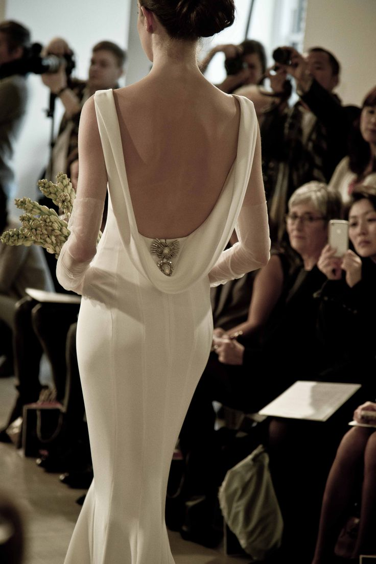 "Okay, @Kathryn Schneider, this isn't decorating related.  But I vote sexy back on your dress!  ""This back is everything. #OscarBridal http://www.ninagarcia.com"""