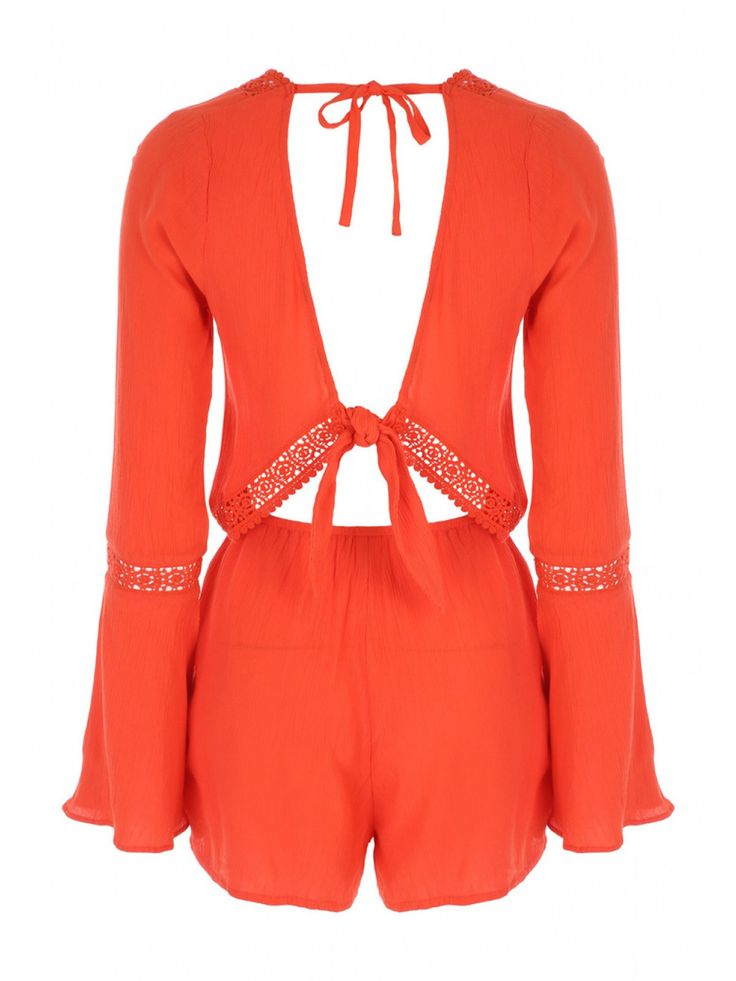 Update your wardrobe for summer by adding a cute playsuit to your collection. This gorgeous bright orange playsuit  features long sleeves, crochet trim and a...