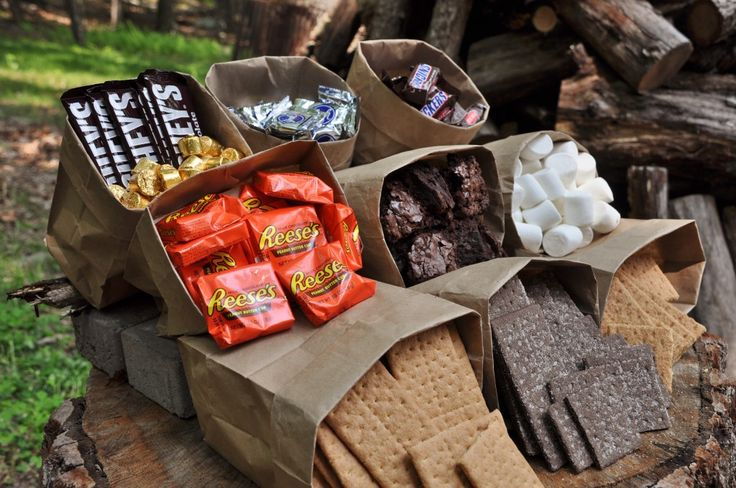 Summer Campfires are synonymous with S'mores. Check out these deliciously, ooey, gooey versions of the original backyard treat. Load up on supplies!! Grab a stick and start roasting! Here are our kiddos roasting their marshmallows over an awesome fire pit in the mountains.  Despite the