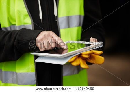 construction worker using digital tablet - stock photo