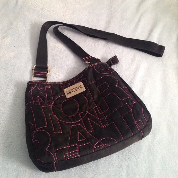 KENNETH COLE CROSSBODY bought from Macy's not too long ago ; great great condition ; NWOT ; never worn; im 5'4 and it falls below my hip ; price is negotiable  Kenneth Cole Reaction Bags