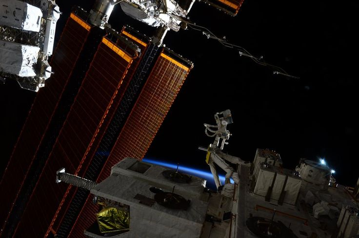 """The blue stripe on the horizon announcing the day barely visible over the """"balcony"""" of #OurOutpostInSpace."""