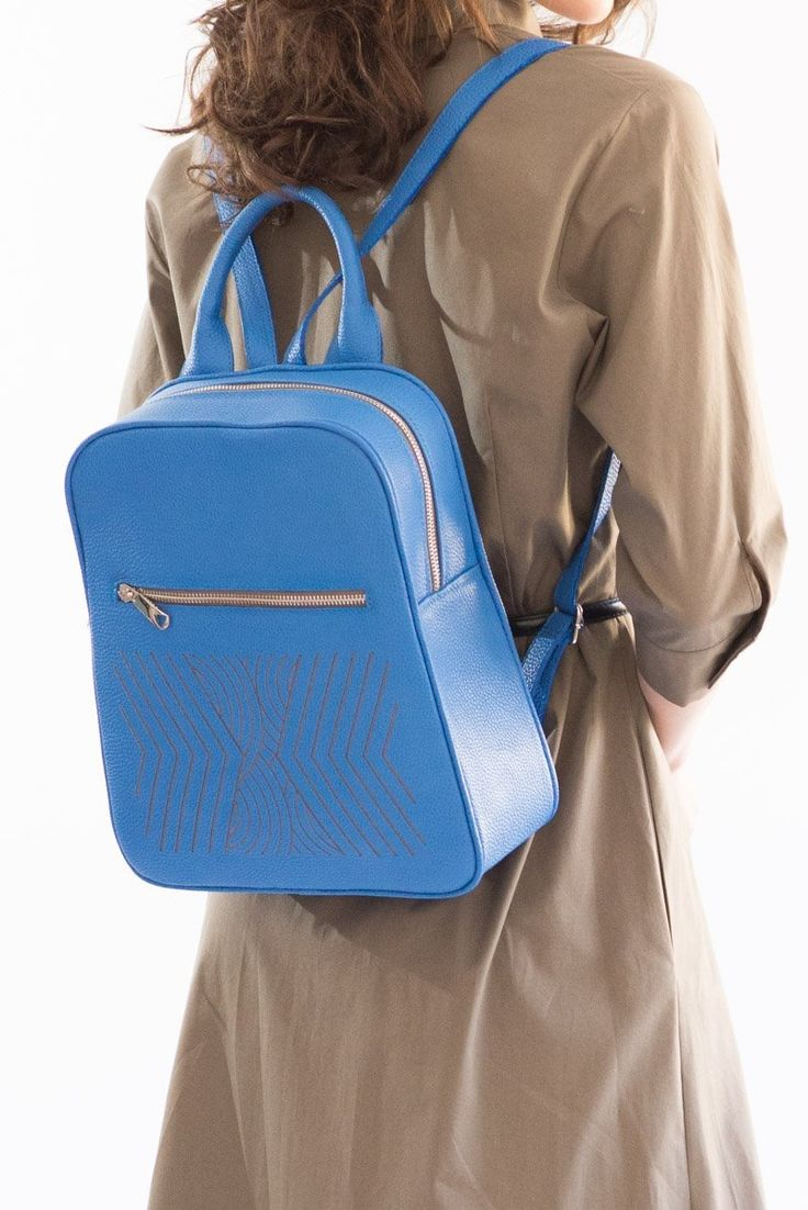 Blue leather backpack with discreet embroideries #iutta #newcollection #backpackstyle