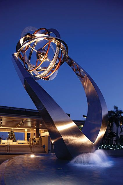 Fantastic sculpture at Marina in Singapore with an armillary sphere at the top designed to mimic a yacht heeling in the wind