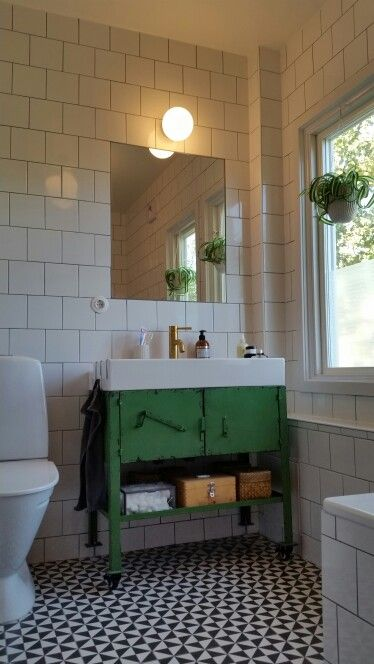 Bathroom- brass, white & green. Tapwell fixtures, Nordal metal storage, Byggfabriken lighting.
