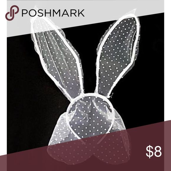 "NWT POLKA DOT LACE BUNNY EARS HEADBAND WITH VEIL Popping up in fashion spreads around the globe are these super sexy lace bunny ears with a veill! This headband has flexible wire bunny ears to pose! As seen on Khloe Kardashian and Ariana Grande!  12"" LENGTH X 0.75"" HEIGHT Accessories Hair Accessories"