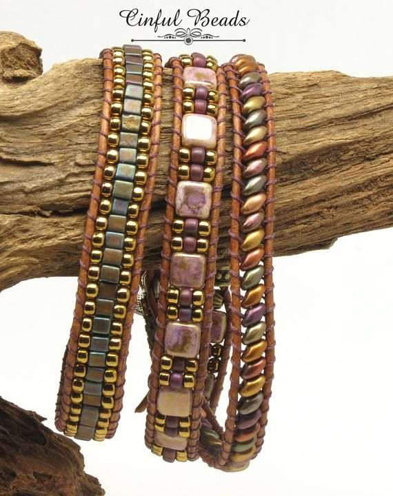 A stylish Bohemian bracelet. This bracelet has 3 sections and features different beads in each section. The first section is composed of matte metallic iris superduos. The center section is made of Czechmate tiles in opaque gold smoky topaz separated by Japanese seed beads. The