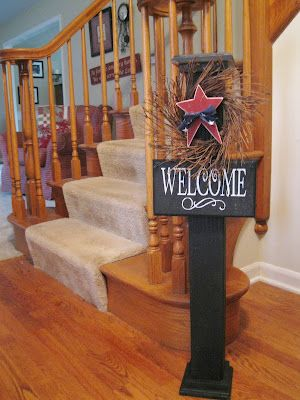 Welcome post with seasonal decorations...   Leave the twiggy wreath up all year and add a wooden ornament to represent the month, holiday, etc.