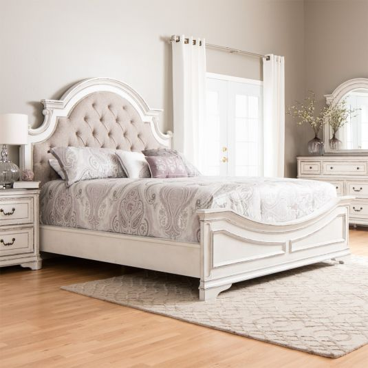 With a blend of European influences and generous proportions, the elaborate style of the Savannah bedroom collection will add elegance to your master suite. The headboard is upholstered in a cotton polyester blend and accented with button tufting. A vintage worn patina finish adds depth and richn...