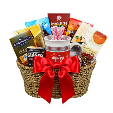 Wonderful sea grass basket holding a festive holiday mug and a variety of teas and treats. Great gift for the tea enthusiast.