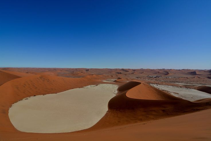 Visited Sossusvlei on our journey through Namibia whilst travelling the world. Absolutely one of the places to see before you die. The most beautiful desert I've ever seen.