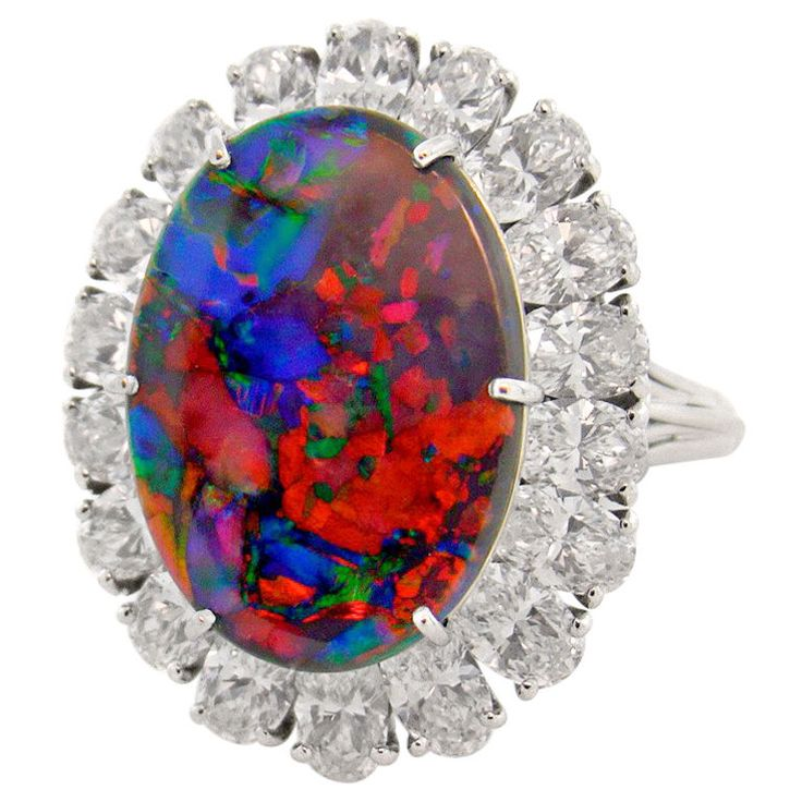 #Opal is the birthstone for October.  This CARTIER Magnificent Black Opal Ring is a STUNNING example of an Australian Lightening Ridge Black Opal.  Did you know that RED is the most valued color in opal?  The Diamond Girl saw this ring priced at almost FIFTY thousand dollars!!!  WOW!!!  GORGEOUS!  <3!