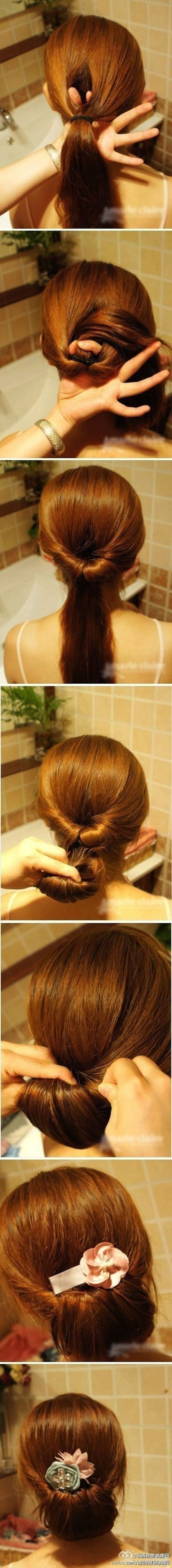 The middle section of the ponytail should be pinned away from your face. The other two remaining sections should be used to create the bow. Shape them into the sides of the bow and pin them down. The hair that you initially sectioned off separate from the ponytail can then be used to create the poof of a braid that hides the ponytail.