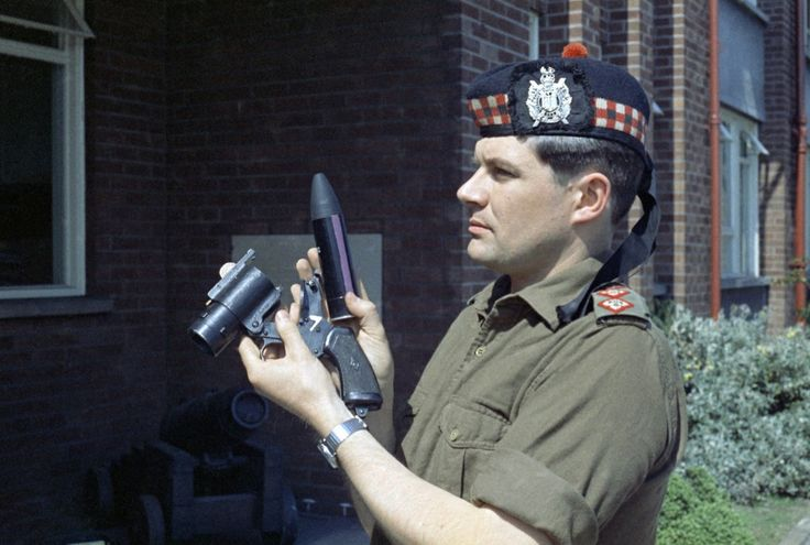 British; King's Own Scottish Borderers,Captain Young with the Army's then new anti-riot weapon - the rubber bullet. 1970