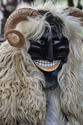 Participant at the Busójárás carnival in Mohacs. The Busójárás is a celebration held exactly seven weeks before Easter and involves locals dressing up in sheepskin costumes with scary masks and noise-makers.