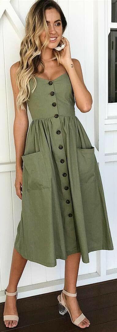 Buttons, pockets, love that cut of dress!