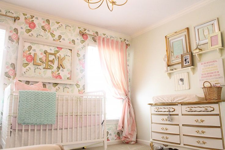 Vintage Glam nursery featuring floral wallpaper accent wall