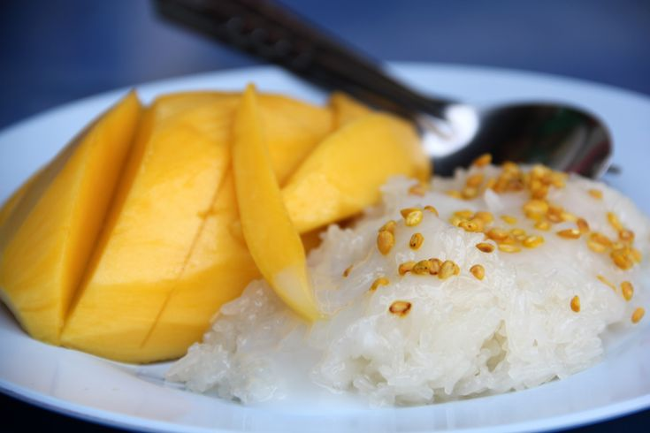 Khao Neow Mamuang (Sticky rice and mango) - One of the most prized Thai desserts is sweet sticky rice paired with ripe yellow mango and doused in coconut cream.