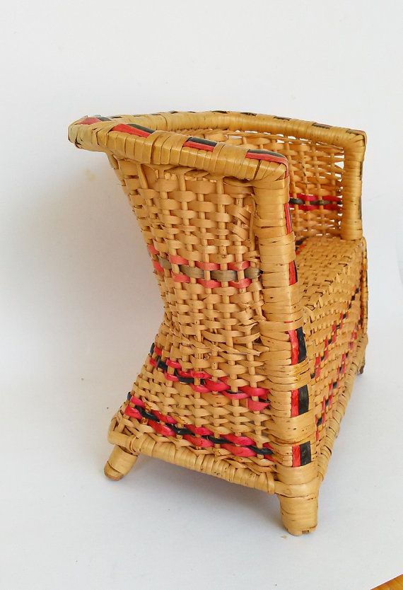 Gorgeous wicker doll sofa. The sofa features a red and black stripe woven design with a high back and sides. The chair is well constructed with a wooden base under the sitting area with bamboo legs. The sofa measures 11 inches long 8.5 inches tall and 5.5 inches wide.  In very good condition with 2 brakes on the wicker on the front #3 photo. On one leg the wicker is loose. Overall very good vintage condition. SHIPPING: We gladly ship overseas. Please email for pricing To save you money…we…