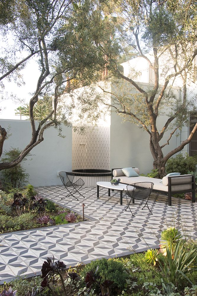 Patterned tiles add an exotic appeal to this tranquil outdoor area.