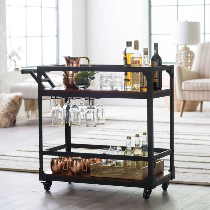 For the wine and spirit connoisseur, gift them this versatile bar cart for all their hosting needs. Featuring two generous shelves to hold your bottles, barware, serveware, and accoutrements, this bar cart makes it easy for you to access your drink-making essentials and for guests to reach their drinks of choice.