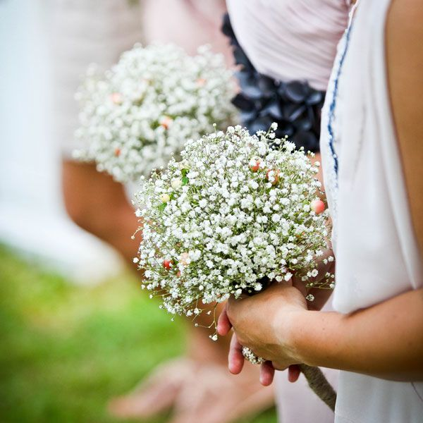Baby's breath bridesmaid bouquets. I kinda love these. Isn't there a teeny blue flower kinda like baby's breath?