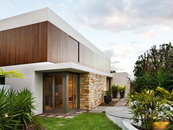Sandstone, timber and glass combined: The Warringah House by Corben Architects