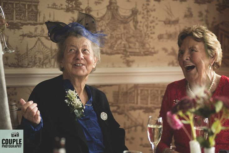 The two grandmothers share a laugh at the wedding reception. Weddings at Durrow Castle photographed by Couple Photography.