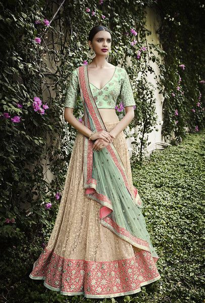 PALLU: Pallu with sea green net fabric and with unique border all over on it. SKIRT: Skirt in self embroidered on beige color net and with heavy border. INNER: