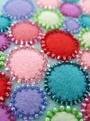 felt circles and beads, would also be good as the back of a cross stitched ornament with the beads showing on both the front and back