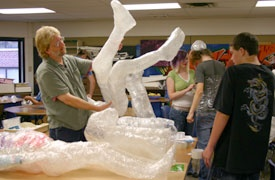 Metro Teacher Jim Jacobmeyer talks with a student about his tape sculpture.    I tried this before, but the kids were too young. I think its time to try in high school sculpture class.
