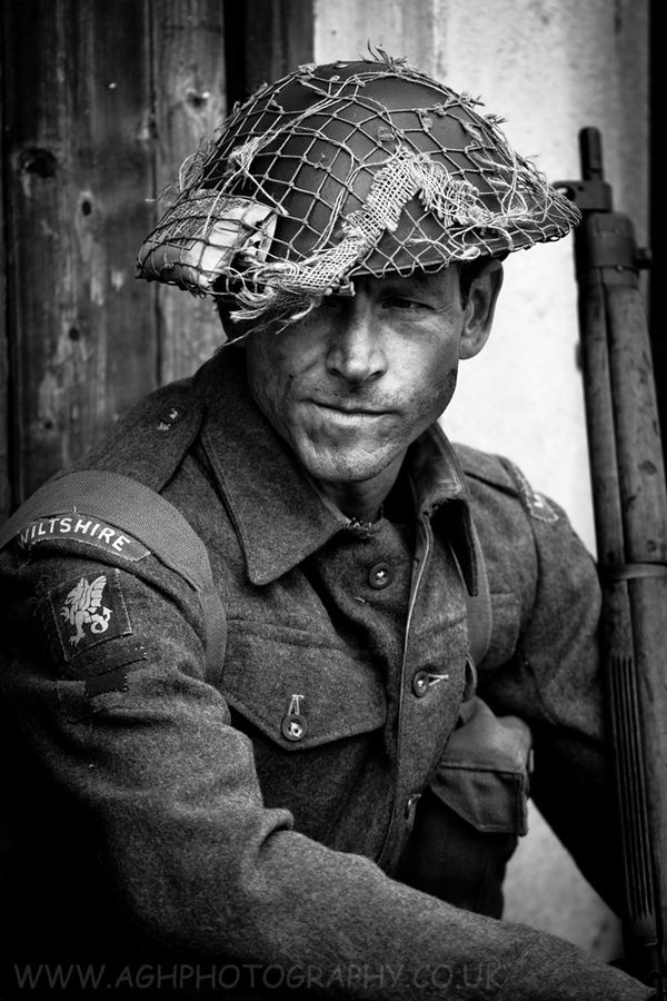 This is not a British Soldier of the Wiltshire regiment in WW2 with a steely determination and a desire to get the job done. He is a modern model wearing period uniform.