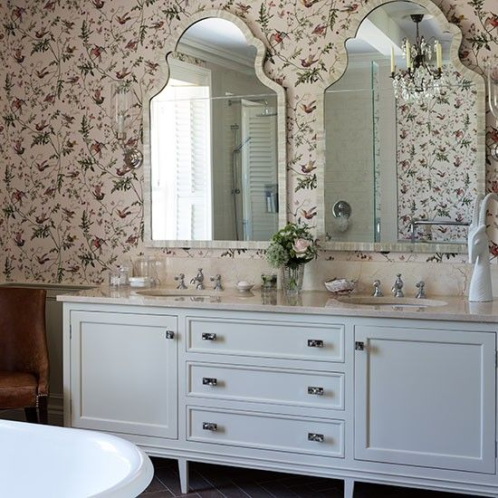 Images Of A pretty hummingbird patterned wallpaper softens the look of this bathroom Twin inset basins