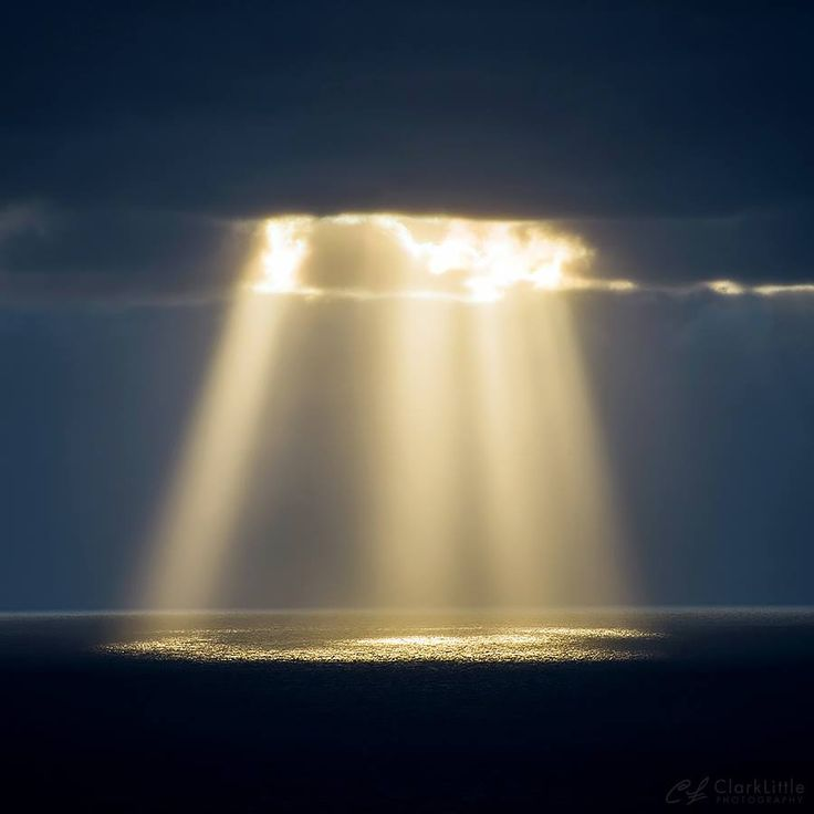 A beam shinning down at sunset tonight. North Shore of Oahu. Clark Little Photography