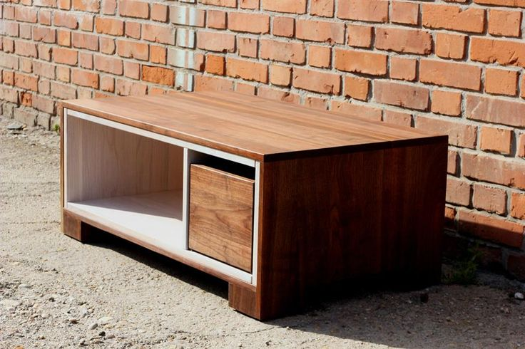 This coffee table was made of American walnut and a painted oak tree. We made mobile version with concealed trundles. And you can move it easily in the rooms. Size  Width: 120 cm Depth: 60 cm Altitude: 52 cm In a discretionary size can be ordered.