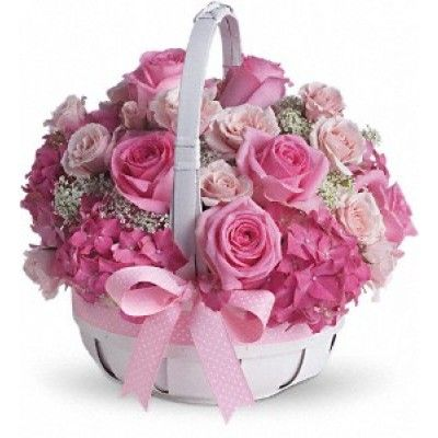 """Thank heaven for little girls! And for adorable arrangements like this one! Perfect for new moms, new babies and girly-girls of all ages, this sweet basket of pink petals is sure to get a warm welcome! Pretty pink hydrangea, roses and spray roses along with Queen Anne's lace are delivered in a charming white basket that's all wrapped up with a pink bow. Say hello to beauty, cutie! Approximately 11 1/2"""" W x 12"""" H"""