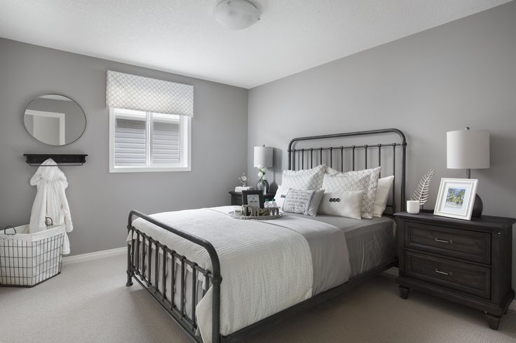 Secondary bedroom in Shane Homes' Tofino II Showhome in Redstone in northeast Calgary #bedroom