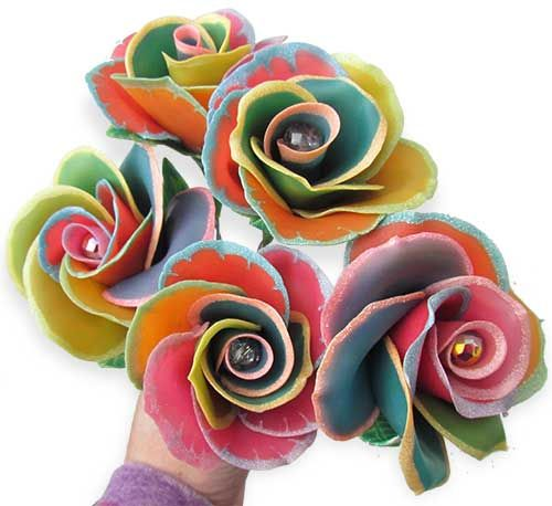 """Polymer rainbow roses, Ann Duncan Hlavach knows her roses. The color tricks she learned in a recent class in Chicago with Lindly Haunani took her flowers to a new level. """"I think my head may have exploded,"""" she says.  Rainbow roses are a real phenomenon. Here's a tutorial on how to tint a natural white rose. http://pinappu.hubpages.com/hub/How-to-make-Rainbow-Roses-a-Step-by-Step-Guide"""