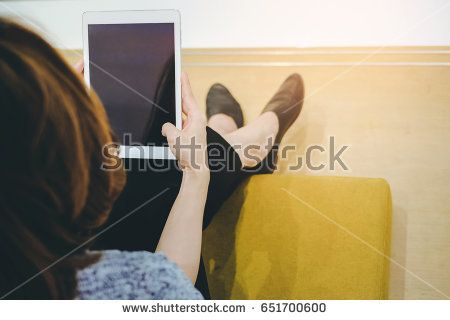 Top view of Young asian woman using tablet in modern office or shopping mall
