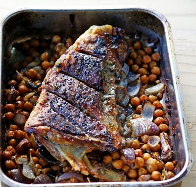 Breast of Lamb roasted with onion and spiced chick peas (garbanzo beans)