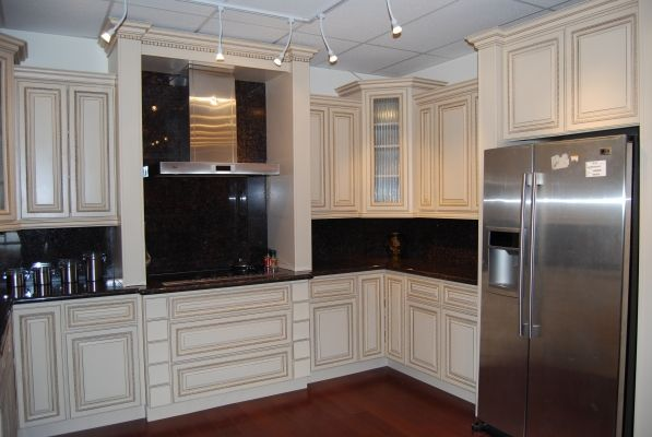 antique white cabinets with black countertops.  I am no stainless steel fan though.