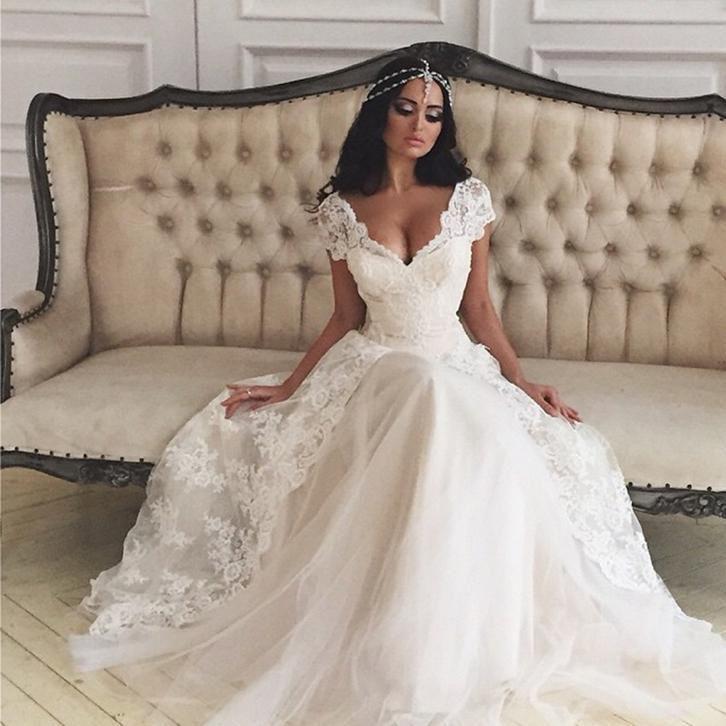 Prachtige prinsessen trouwjurk van tule en kant met V rug