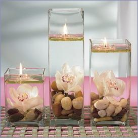 Water + vegetable oil + water candle = illusion of floating candle and 800 hrs of burning time. :)