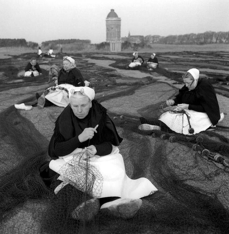 Dutch women repairing the fishing nets in Scheveningen.  Ph. Cas Oorthuys #ZuidHolland #Scheveningen