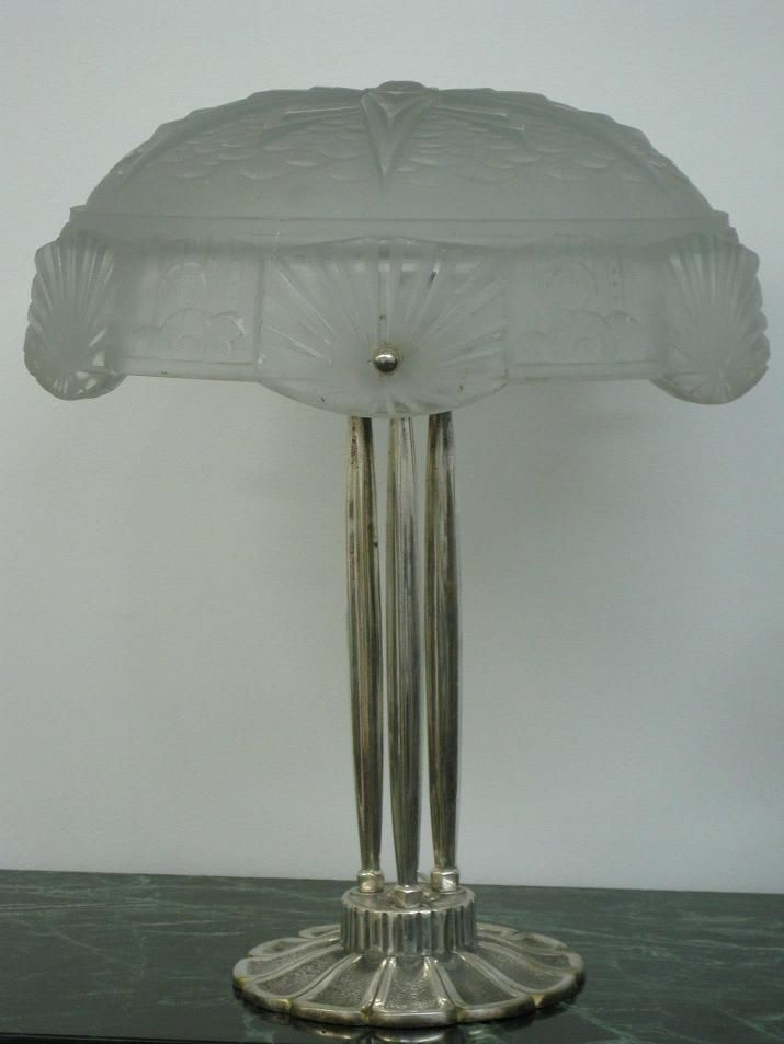 """Muller Frères Table Lamp - A French Art Deco Table Lamp signed by the French artist """"Muller Frères Luneville"""" in clear frosted molded Glass Shades enhanced by intricate geometric motif with polished details. Three ribbed stems with embellished Art Deco ornamental design of a round flower paddles base in Silvered Bronze.  Reference #: TL8701  Measurement: Height: 16.5 in. (41.91 cm) Diameter: 14 in. (35.56 cm) Shade Height: 6 in. (15.24 cm ) Diameter: 14 in. (35.56 cm)"""