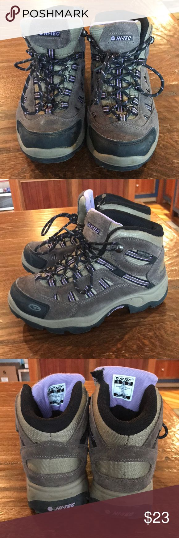 Hi-Tec hiking boots Size 7.5 hi-Tec hiking boots. Very lightly worn, still LOTS of Tread left. If my puppy hadn't gotten ahold of these, they would be in perfect condition. There are two small blemishes in one shoe as pictured where you can see she bit them. But it isn't noticeable in my opinion. Colors are gray and light purple.  These are waterproof. Hi-Tec Shoes