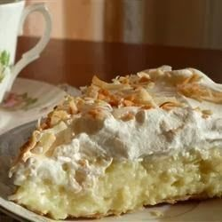 Old Fashioned Coconut Cream Pie | Sweetened toasted coconut is stirred into a homemade custard filling and poured into a pie shell. After the pie is chilled and set, it's covered with whipped topping and more toasted coconut,,
