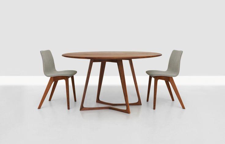 Versandkostenfrei online bestellen: Tisch Twist von Zeitraum Möbel. Massiver runder Design-Holztisch auch als rechteckige oder ovale Variante erhältlich.