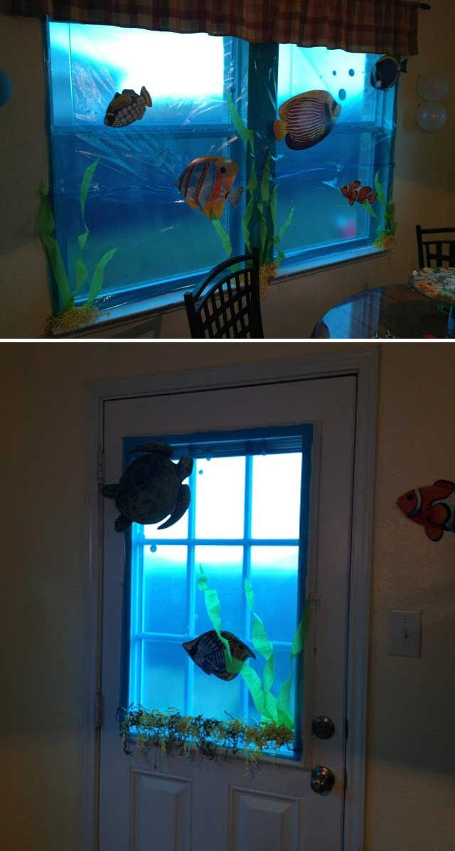 """Bring the feel of """"under the sea"""" to party home by using blue cellophane to cover windows and adding underwater creatures."""